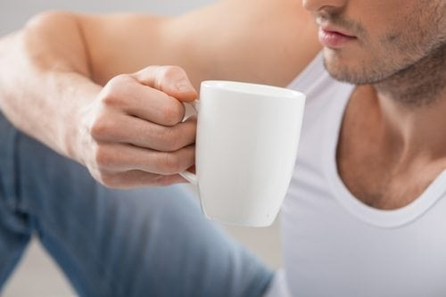 sexy man drinking coffee