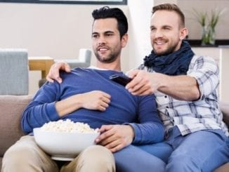 gay couple couch tv