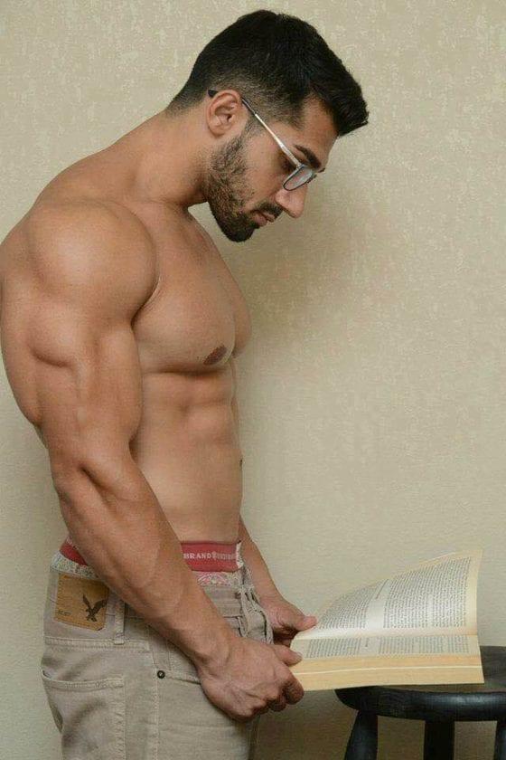 shirtless man reading