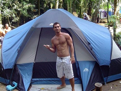 handsome man camping tent