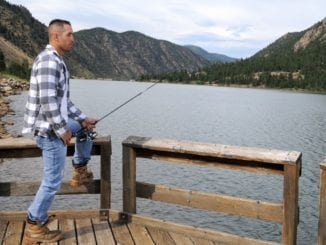 rugged attractive man fishing
