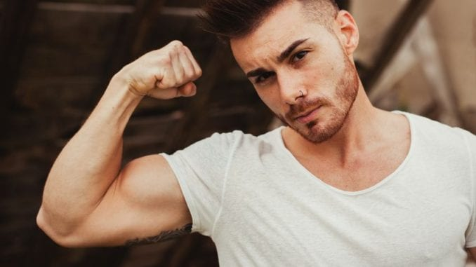 sexy young guy with a tatto on muscular bicep
