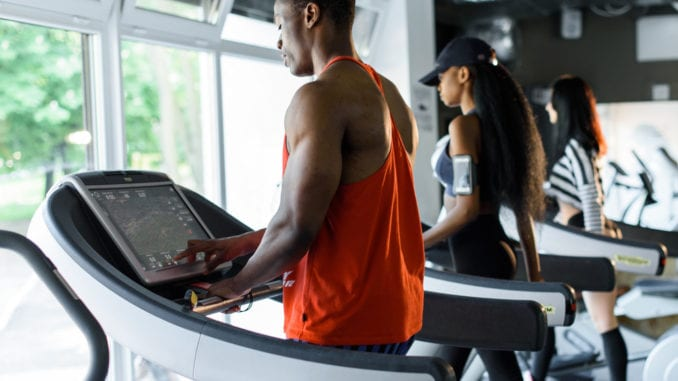 exercise on treadmill attractive black man