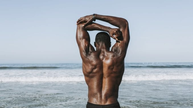 man stretching attractive black man working out