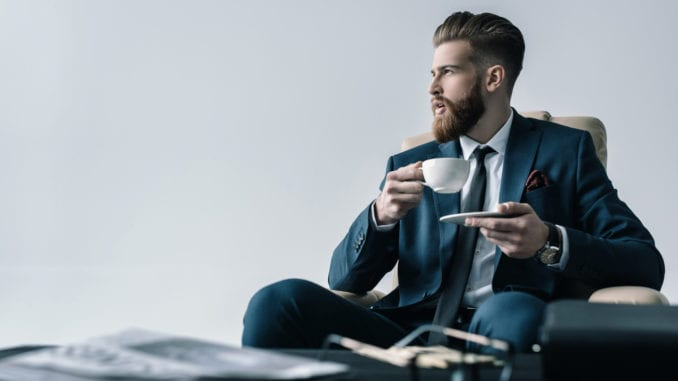 attractive man drinking coffee suit cancer prevention