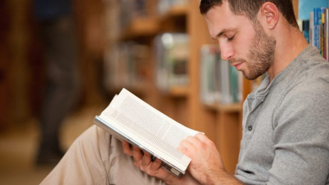 young man student reading classical literature
