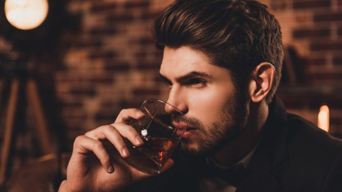 attractive man whiskey