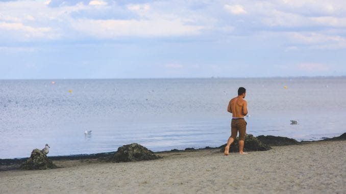 man running beach relationship break