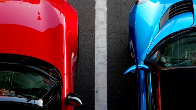 electric car battle Tesla Model S vs Porsche Taycan