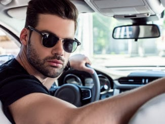 attractive bearded man driving car