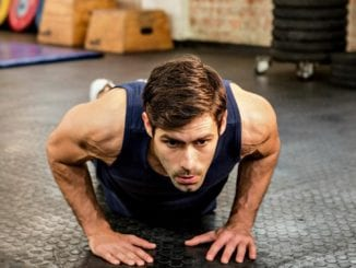 athletic man doing pushups