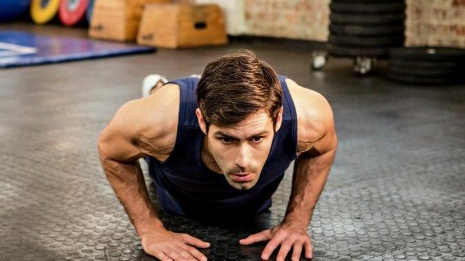 athletic man doing pushups