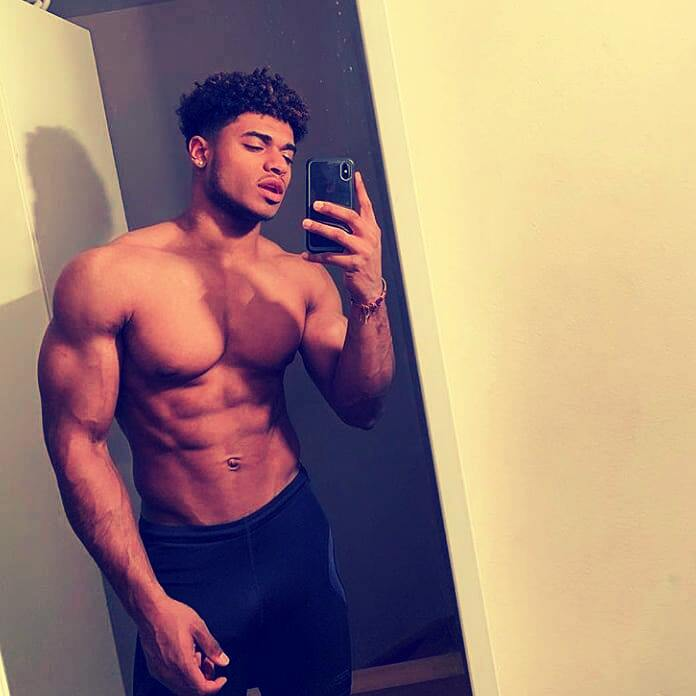 black athlete in front of mirror