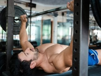 male bodybuilder gym bench press