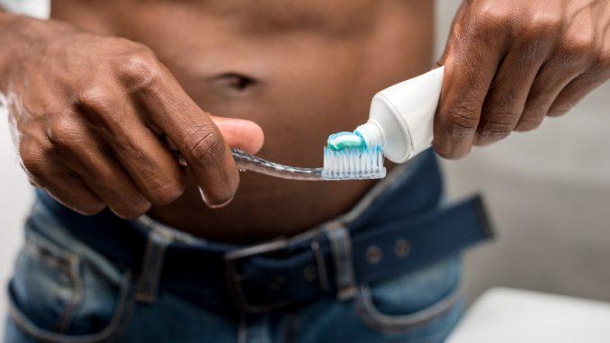 attractive man toothpaste